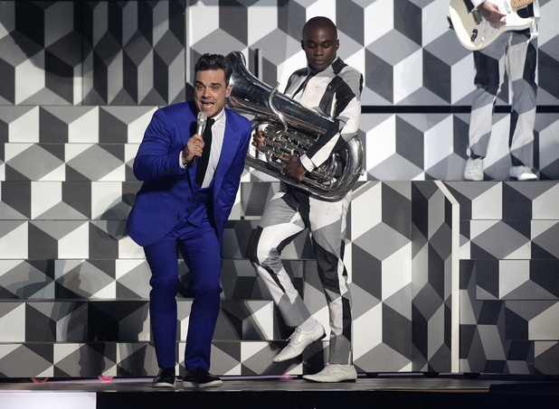 Robbie Williams performs during the 2013 Brit Awards at the O2 Arena, London.