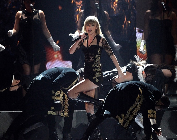 Taylor Swift performs during the 2013 Brit Awards at the O2 Arena, London