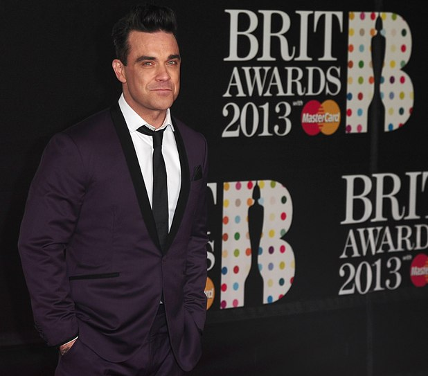 Robbie Williams arriving for the 2013 Brit Awards at the O2 Arena, London