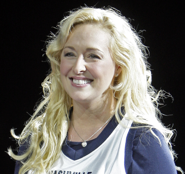 Mindy McCready sings at a basketball game in Nashville
