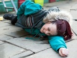 Sinead falls and lands on the pavement.