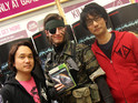 Hideo Kojima poses with fans at the Metal Gear Rising: Revengeance UK launch.