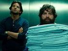 Watch Bradley Cooper and Zach Galifianakis walk the London red carpet.