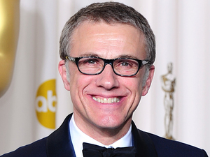 Christoph Waltz is rushed off the stage during a Canal Plus interview.