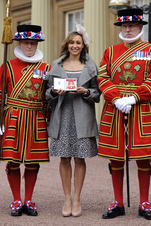 Jessica Ennis with yeomen of the guard at her CBE investiture