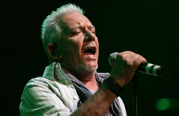 Eric Burdon performs on stage with WAR at the Royal Albert Hall in London.