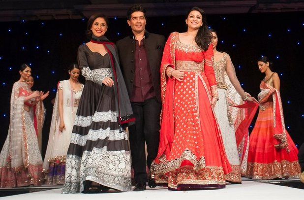 Urmila Matondkar and Parineeti Chopra take part in a fashion show for The Angeli Foundation in London (pictured with Manish Malhotra)
