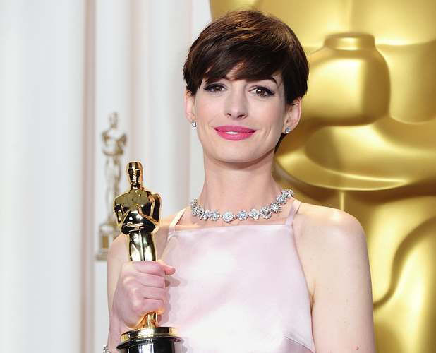 Anne Hathaway with her &#39;Best Supporting Actress&#39; Oscar