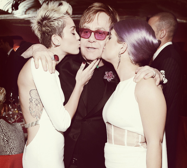 WEST HOLLYWOOD, CA - FEBRUARY 24: (EDITORS NOTE: Image was processed using Digital Filters) An alternate view of actress/singer Miley Cyrus, Sir Elton John and tv personality Kelly Osbourne at the 21st Annual Elton John AIDS Foundation Academy Awards Viewing Party at Pacific Design Center on February 24, 2013 in West Hollywood, California. (Photo by Michael Kovac/Getty Images for EJAF)