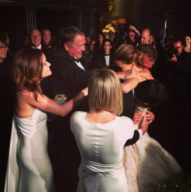 Jennifer Lawrence hugging her family after her win at the Oscars 2013