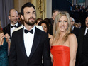 She dismisses reports that her wedding to Justin Theroux has been canceled.
