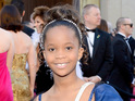 The 9-year-old nominee imitates Morgan's English accent on the red carpet.