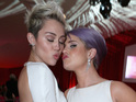 The best friends get close and pucker up at Elton John AIDS Foundation's Oscar dinner.