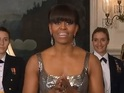 First Lady's dress is digitally altered by news agency to appear less revealing.