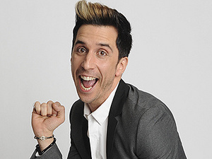 Russell Kane, who presented the BAFTA for Game Design strikes a pose at the BAFTA Games Awards 2013