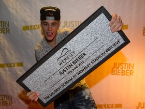 Justin Bieber is indcuted into the Wembley walk of fame with a Wembley Stone