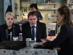 Lucy accompanies Ian to a meeting with a financial advisor.