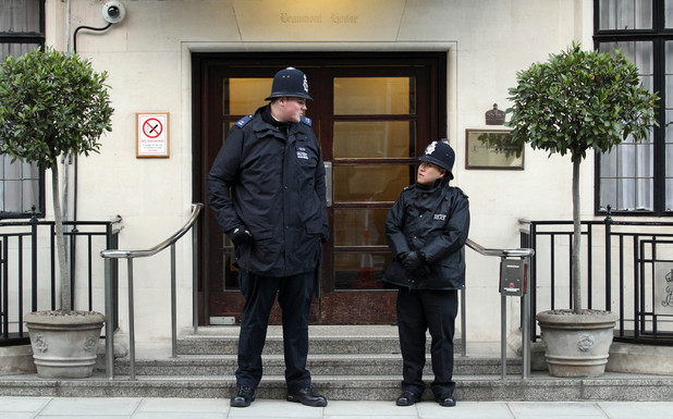 Pc Anthony Wallyn, 7ft 2in, Pc Tony Thich, who is 5ft 6ins, King Edward VII's Hospital, central London, as Queen Elizabeth II recovers after being admitted with symptoms of gastroenteritis.