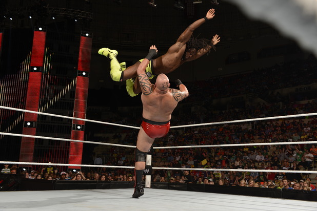 Kofi Kingston tackles an opponent at Raw