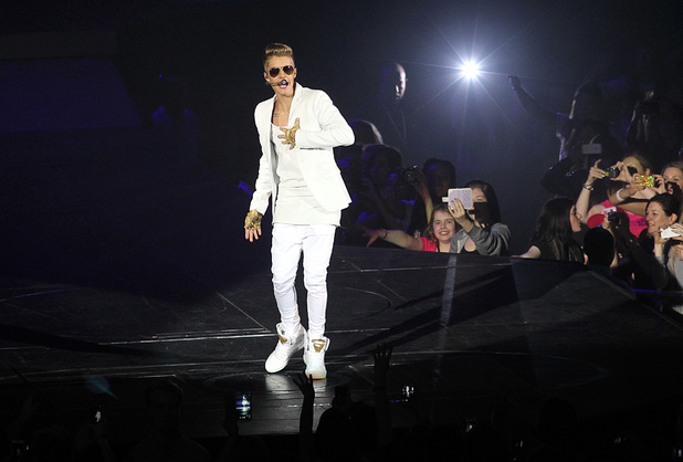 Justin Bieber performing in London