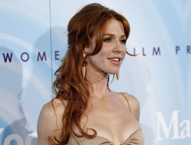 Poppy Montgomery arrives at the Crystal Lucy Awards on Thursday June 16, 2011 in Beverly Hills, Calif.