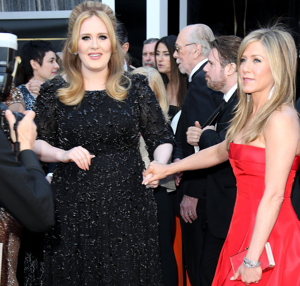 HOLLYWOOD, CA - FEBRUARY 24: (L-R) Adele and Jennifer Aniston arrive at the 85th Annual Academy Awards at Hollywood & Highland Center on February 24, 2013 in Hollywood, California. (Photo by Dan MacMedan/WireImage)