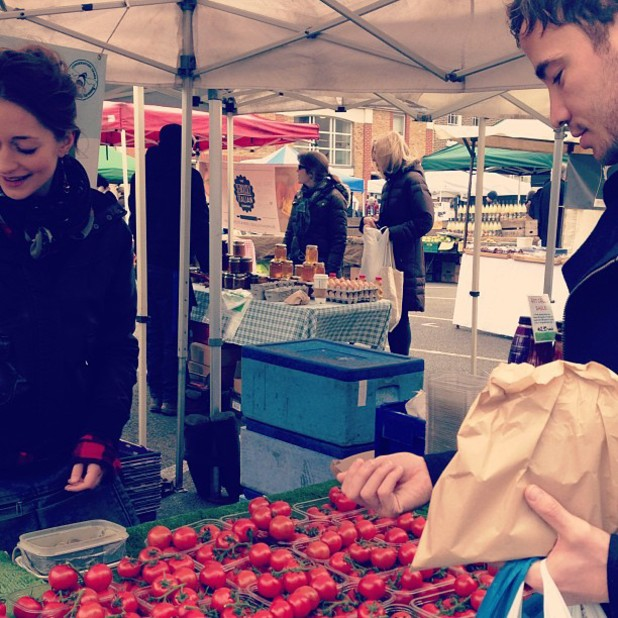 Kelly Brook and Danny Cipriani buy tomatoes at a farmers' market