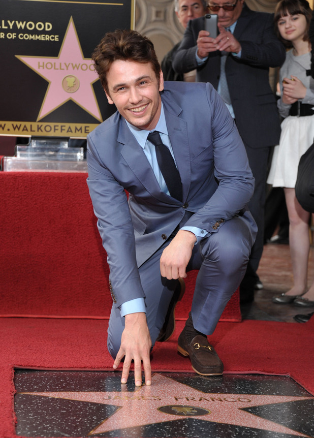 A smiling James Franco poses with his new star at the Hollywood Walk of Fame