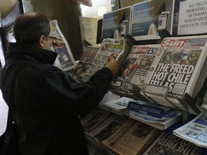 Copies of newspapers on sale
