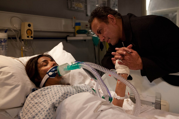 Dev at Sunita's bedside after the Rovers fire