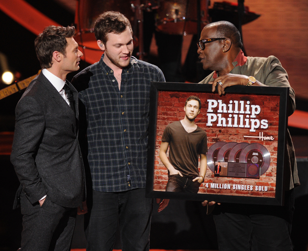'American Idol' Top 10 results show: Phillip Phillips is presented with a platinum disc by Randy Jackson