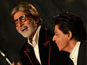 Amitabh signs 'Don' poster for Khan