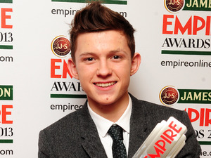 Tom Holland with the Best Male Newcomer award.