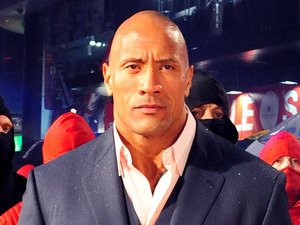 Dwayne &#39;The Rock&#39; Johnson (centre) arrives for the UK premiere of GI Joe: Retaliation at the Empire Cinema in London.