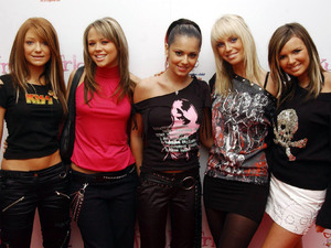 Girls Aloud attend the premiere of 'Freaky Friday' in December 2003.