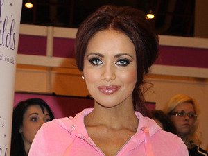 Amy Childs wearing a pink 'onesie' at Day 2 of the Vitality Show at Earls Court.
