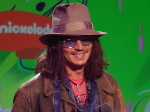 Johnny Depp accepts the award for favorite movie actor for Dark Shadows.