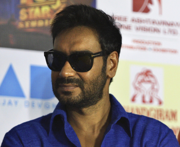 "Ajay Devgan and Abhishek Bachchan arrive for a promotional event for their new film '""Bol Bachchan'"" in New Delhi, India, Wednesday, July 4, 2012. The romantic comedy is scheduled to be released on July 6."