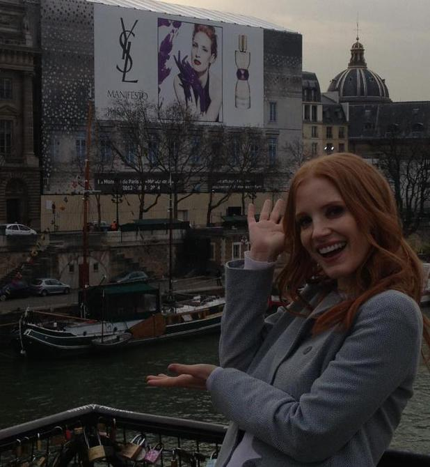 Jessica Chastain poses with her Yves Saint Laurent billboard
