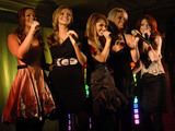 Girls Aloud sing at the Harrods Christmas Parade in November 2006