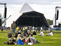 Glastonbury festival-goers at the Pyramid Stage