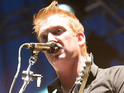 Josh Homme performing with Them Crooked Vultures