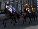 The clip sees a group of jockeys race through the city of Liverpool.