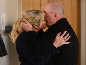 Phil and Sharon share a kiss.