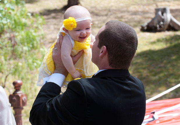 Toadie holds Nell at the wedding