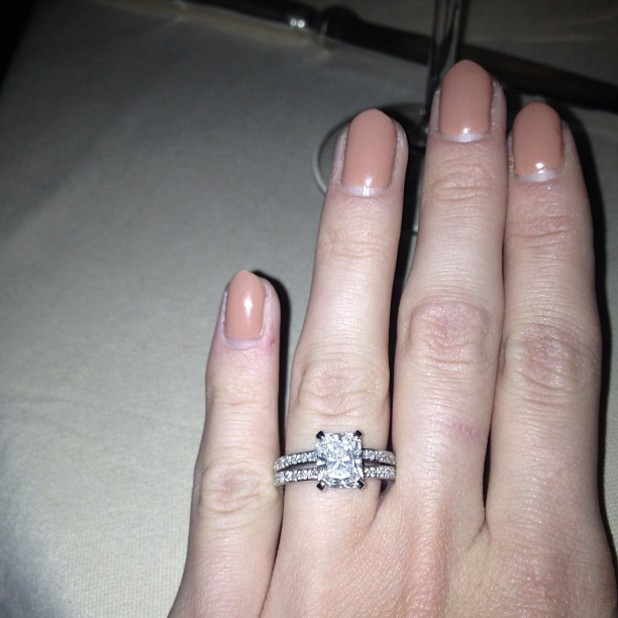 Millie Mackintosh shows off an engagement ring on her left hand