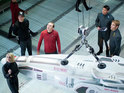 Enterprise crew members are pictured alongside a mysterious device.