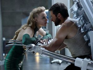 Svetlana Khodchenkova as Viper and Hugh Jackman as Logan in 'The Wolverine'