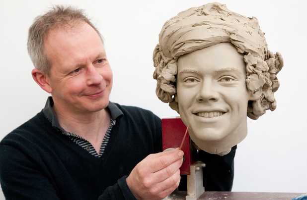 Madame Tussauds Sculptor Jim Kemp works on the clay head for One Direction's Harry Styles