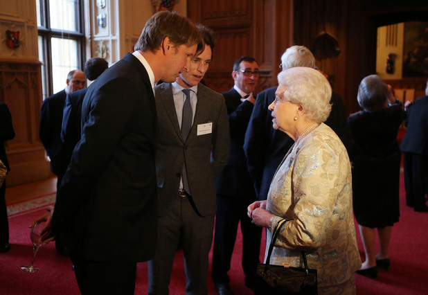 Queen Elizabeth II meets Tom Hooper and Eddie Redmayne